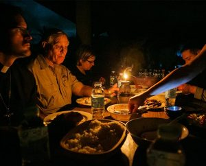 Members of the LCMS Disaster Response team, including, from left, Rev. Steven Schave, Rev. Glenn Merritt, Deaconess Pamela Nielsen, Rev. Michael Meyer and Michelle Cagnin, eat by candlelight at Christ Lutheran Church in the village of Mahayag, Leyte Province, the Philippines, on Nov. 17. The church was badly damaged by Typhoon Haiyan. (LCMS Communications/Erik M. Lunsford)