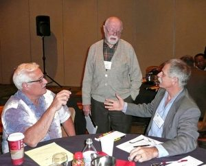 During a break at the first LCMS Mission Summit, Nov. 21-22 in San Antonio, participants discuss ideas raised by summit presentations. In the foreground, from left, are the Rev. Dr. Anthony Steinbronn, president of the LCMS New Jersey District; the Rev. Dr. Eugene Bunkowske, emeritus professor of Christian Outreach at Concordia University, St. Paul, Minn.; and the Rev. Dr. Paul Mueller, director of the Center for Applied Lutheran Leadership at Concordia University Portland in Portland, Ore. (LCMS Communications/Megan K. Mertz)