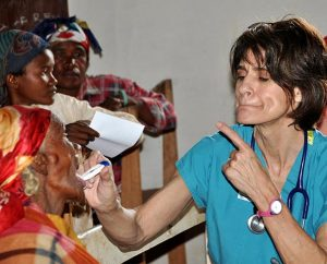Mercy Medical Team (MMT) member Meredith Davis teaches a patient how to have her temperature taken during an MMT trip to Madagascar in March 2013. The team treated 1,321 patients and filled 4,000 prescriptions there. Five trips are planned for 2014. (Sharon Thomas)