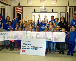 Students and staff of Dubuque Lutheran School in Dubuque, Iowa, celebrate winning $25,000 for the school in the U.S. Cellular Calling All Communities contest Dec. 10. The school has 35 students in kindergarten through fifth grade. (Linda Nudd)