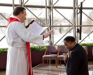 Synod President Rev. Dr. Matthew C. Harrison installs the Rev. Roosevelt Gray as the director of LCMS Black Ministry Jan. 7 at the chapel  in the Synod's International Center. (LCMS Communications/Frank Kohn)