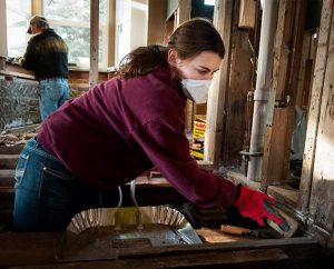 Kelsey Bergquist, a student at South Dakota State University, helps gut the interior of a home damaged by September flooding on Jan. 8, 2014, in Lyons, Colo. Bergquist is one of seven students who traveled to the hard-hit area to do volunteer relief work. (LCMS Communications/Erik M. Lunsford)