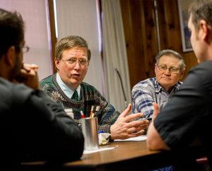 The Rev. Timothy Mueller of Saint John Lutheran Church, New Minden, Ill., talks with LCMS Disaster Response staffers Rev. Ross Johnson, left, and Rev. Michael Meyer, right, during a meeting in New Minden on Dec. 18, 2013. Next to Mueller is Dennis Windler. (LCMS Communications/Erik M. Lunsford)