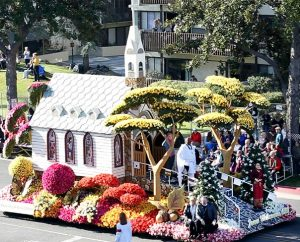 "LCMS President Rev. Dr. Matthew C. Harrison and his wife, Kathy, lower right, ride on the Lutheran Hour Ministries Rose Parade float Jan. 1 in Pasadena, Calif. The float's ""Jesus Welcomes All"" theme depicted people of various nationalities being welcomed into a church with open doors, illustrating that ""all tribes and nations would come to know Christ as Lord."" (Lutheran Hour Ministries)"