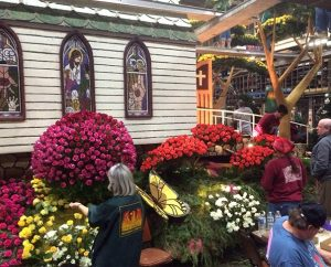 """Petal Pusher"" volunteers work on the Lutheran Hour Ministries (LHM) float prior to the 2014 Rose Parade. The LHM float — the only one with a Christian theme among more than 40 entries — received the Princess Award trophy. (Matthew C. Harrison)"