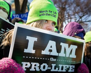 "Marissa Troyke, a student at Concordia University Wisconsin in Mequon holds a sign declaring ""I am the pro-life generation"" at the 41st ""March for Life,"" Jan 22 in Washington, D.C. (LCMS Communications/Erik M. Lunsford)"
