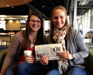 Rebecca Monnier, left, and Louisa Mehl hold a copy of the Lincoln Journal Star featuring a story about their 2012 trek to Tanzania and how they raised more than $50,600 in donations for the Lutheran Malaria Initiative. Monnier and Mehl are seniors at Concordia University, Nebraska, in Seward, Neb. (Dionne Lovstad-Jones)