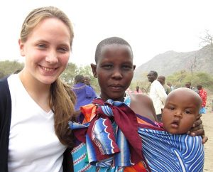 Louisa Mehl poses for a photo with a young Maasai woman and her child in a rural area of northeastern Tanzania on July 26, 2012, as part of a Lutheran World Relief fellowship for college students. (Mai Vu)