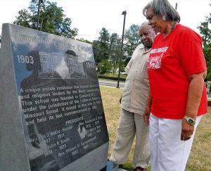 The Rev. Dr. Bryant E. Clancy Jr. of St. Louis and Dr. Cynthia Roddy of Catawba, S.C., read a marker in Greensboro, N.C., at the site for the campus of the Synod's Immanuel Lutheran College, of which both are graduates. That site now is occupied by North Carolina A&T University, where the 2012 LCMS Black Ministry Convocation took place. (LCMS Communications/Joe Isenhower Jr.)