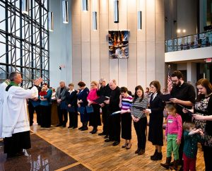 The Rev. Randall Golter, executive director of the LCMS Office of International Mission, leads prayer during the Rite of Sending for missionaries on Feb. 14, 2014, at the LCMS International Center in St. Louis. (LCMS Communications/Erik M. Lunsford)
