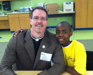 The Rev. Steve Schave sits with Remi, a student at John P. Park Elementary School whom Schave tutored and mentored while serving as pastor of St. Paul Lutheran Church, Cincinnati. (St. Paul Lutheran Church circa 2012)