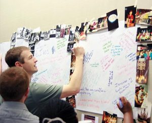 "The Rev. Derek J. Broten, a member of the National LCMS Youth Gathering executive team and co-director of the Gathering's ""Mass Events,"" adds a comment to a poster during a creative session at the Gathering theme-development meeting Jan. 20 in New Orleans. He is pastor of Woodbury Lutheran Church, Woodbury, Minn. (LCMS Youth Ministry/Amy Gray)"
