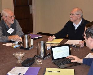 The Rev. Donald Pritchard of Pleasant Plains, Ill., left, makes a point during LCMS Specialized Pastoral Ministry's (SPM) March 10-11 gathering in St. Louis of 10 emergency-services chaplains who beta-tested an ecclesiastical-endorsement process for such chaplains.  Listening are the Rev. Joel Hempel, center, the Synod's manager of SPM, and the Rev. Frank Ruffatto of Charleston, W.Va. (LCMS Communications/Joe Isenhower Jr.)