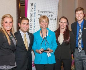 Teammates from Concordia University, St. Paul, Minn., display their first-place trophy at the third annual – and most competitive to date– Lutheran Church Extension Fund National Student Marketing Competition, April 4, at the LCMS International Center in St. Louis. The team included, from left, Amanda Konetchy, Thomas Streed, faculty advisor Dr. Nancy Harrower, Kayla Koenecke and Matt Buhmann. (Lutheran Church Extension Fund)