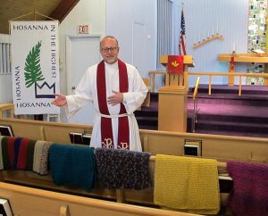 The Rev. David Weeks, pastor of Calvary Lutheran Church, Murrysville, Pa., blesses prayer shawls April 13 that Calvary members made for the families of victims and the suspect after the April 9 stabbings at Franklin Regional High School, which is across the street from the church. (Calvary Lutheran Church/Steve Wutzke)