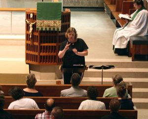 "A student in the Church Interpreter Training Institute (CITI) ""signs"" during a chapel service at Concordia Theological Seminary, Fort Wayne, Ind. The 2014 CITI is planned for June 15-27 at the seminary. (Concordia Theological Seminary)"