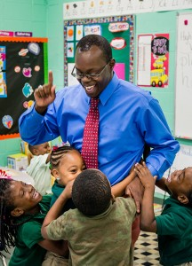 Students hug teacher Jonathan Clausell near the end of class at Trinity Evangelical Lutheran School.