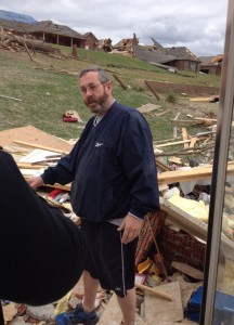 Jimmy Womack, a member of Shepherd of Peace Lutheran Church in Maumelle, Ark., shows what is left of his home — a pile of rubble — after an EF4 tornado hit Mayflower, Ark., April 27. He, his wife, Mary, and their 3-year-old daughter survived by hovering in a bedroom closet. The family was not injured but their home was destroyed. (John Gierke)