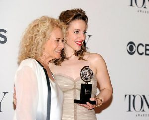 """Carole King, left, poses with Jessie Mueller in the press room at the 68th annual Tony Awards at Radio City Music Hall on June 8, 2014, in New York. Mueller won the """"best actress"""" Tony for her portrayal of King in """"Beautiful: The Carole King Musical."""" (Charles Sykes/Invision/AP)"""
