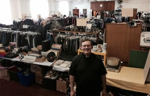 The Rev. David Boisclair stands in front of Faith Lutheran's thrift shop that supports those in need. He is the pastor at Faith Lutheran Church and Bethesda Lutheran Church, both in St. Louis, Mo.