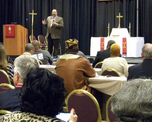 """The Rev. Bart Day, executive director of the LCMS Office of National Mission and interim chief mission officer for the Synod, addresses the convocation in Kansas City. Day described """"healthy congregations"""" as those that respond to the needs of their communities, and he said the Synod offers many resources — and grants — to help congregations do just that. (LCMS/Paula Schlueter Ross)"""