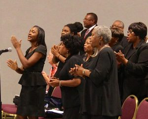 A choir — with members from four St. Louis-area LCMS congregations — leads singing during the convocation. (John Mehl)