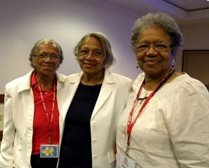 """Sisters — from left, Ida Odom of St. Louis; Mildred Mobley of Omaha, Neb.; and Blanche Dickinson of St. Louis — pose for a photo during the convocation. The three, now in their 70s, began attending Black Ministry Convocations some 30 years ago and have no plans to stop. Odom, who is married to former LCMS black ministry interim director Rev. Dr. Frazier Odom, said she attends convocations to """"know what the church is doing"""" and to """"be part of the growth and change."""" Dickinson, at right, is the widow of longtime black-ministry leader Rev. Dr. Richard Dickinson, who died in 2010. (LCMS/Paula Schlueter Ross)"""