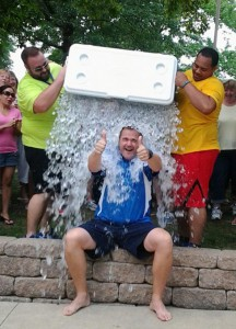 """Jim Sanft, president and CEO of Concordia Plan Services (CPS), takes the """"ALS Ice Bucket Challenge"""" during a CPS employee picnic Aug. 20 at Kirkwood Park. Pouring the water are CPS employees Jason Williams, left, and Curtis Wooten. CPS plans to donate employee pledges of $3,155.52 to an ALS organization aligned with LCMS Life Ministries. (Concordia Plan Services/Diane Mottert)"""