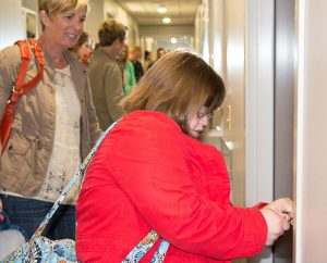Mary Cate Neff opens the door to her new dorm room for herself and her mother, Elizabeth Neff. (Terri Breese/Bethesda Lutheran Communities)