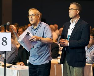 A delegate speaks at the mike during the 2013 LCMS convention in St. Louis. A new Web page that offers updates on the actions of four task forces created by that convention is now available at lcms.org/convention/taskforceupdates. (Michael Schuermann)