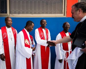LCMS President Rev. Dr . Matthew C. Harrison greets seminarians Feb. 2 before the dedication of new facilities for the Lutheran Theological Seminary of the Evangelical Lutheran Church of Ghana. At the Sept. 29-30 meeting of the LCMS Board for International Mission, Bishop Christian Ekong of the Lutheran Church of Nigeria said that theological education is one of the most important areas with which the LCMS can help in Africa. (LCMS/Erik M. Lunsford)