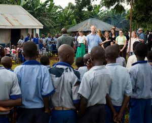 The Rev. Dr. John Juedes, pastor of Messiah Lutheran Church in Highland, Calif., and part of 14-member LCMS Mercy Medical team working in Kenya during June, 1014, addresses Kenyan school children at the site of a one-week clinic. During its most recent meeting, the LCMS Board for International Mission discussed the benefits of and ways to maximize short-term mission teams. (LCMS/Erik M. Lunsford)
