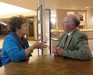 The Rev. Steven Sutterer, a chaplain for Sparrow Hospital in Lansing, Mich., visits with a friend of a patient in that hospital. The LCMS Board for National Mission decided at its Sept. 26-27 to extend a call — its first ever — to Sutterer. (Martha Sutterer)