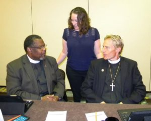 Board for National Mission (BNM) Vice-Chairman Rev. Samuel Cosby, left, welcomes new board members Deaconess Shaina M. Mitchell and the Rev. Timothy J. Droegemueller to the board at its Sept. 26-27 meeting in St. Louis. (LCMS/Joe Isenhower Jr.)