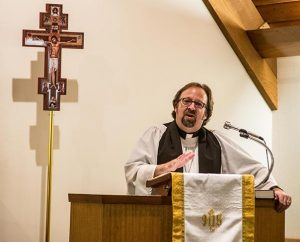 The Rev. Kurt Onken, pastor of Messiah Lutheran Church, Marysville, Wash., preaches during a special Oct. 27 service of healing attended by more than 100 people, including the congregation's high-school students and their families. (Tony Cataldo)