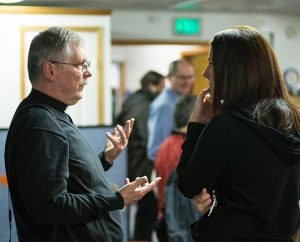 The Rev. Ron Norris, district disaster response coordinator for the LCMS Northwest District and an emergency-services chaplain, talks with Jackie Nolte after the Oct. 27 worship service at Messiah Lutheran Church in Marysville, Wash. Nolte is the mother of 14-year-old Peyton Nolte, an eyewitness to the shooting. (Tony Cataldo)