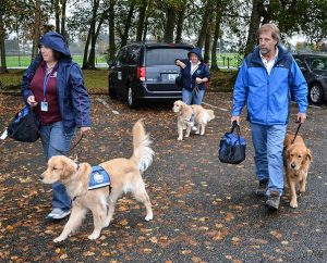 Lutheran Church Charities (LCC) K-9 Comfort Dogs arrive at a site in Marysville, Wash., after the shooting that killed five students at Marysville-Pilchuck High School on Oct. 24. From left are Jeanne Moore with Aaron, Toni Bazon with Shami and Tom Bartnick with Luther. Nearly 40 LCMS churches and schools in 16 states now have their own comfort dogs from Addison, Ill.-based LCC. (Ron Norris)