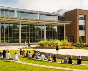 A speaker addresses a class outside the George R. White Library and Learning Center at Concordia University Portland July 11 in Portland, Ore. The university saw its enrollment grow by 37 percent this fall, largely because of its online graduate programs in education. (LCMS/Erik M. Lunsford)