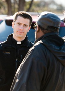 "The Rev. Mark Koschmann listens as a man shares his concerns in Ferguson, Mo. Koschmann, assistant pastor at Chapel of the Cross Lutheran Church, St. Louis, said being among the protesters ""definitely opened my eyes to their frustration"" and he believes the anger ""is larger than one incident — it's just a symptom of some real deep hurt and rawness"" related to feelings of racism. (LCMS/Erik M. Lunsford)"