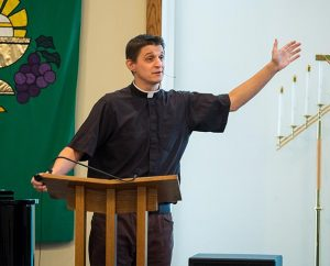 """During a pre-conference track, the Rev. Jonathan Fisk presents his topic, """"What's a Life Worth? — The Human Soul in the (kind of) Infinite Cosmos."""" (Michael Schuermann)"""