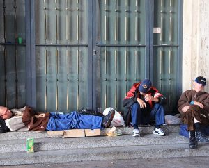 Homeless men sleep just outside of St. Peter's Square at the Vatican on Nov. 13. (Religion News Service/Josephine McKenna)