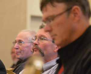 The Rev. Terry Forke, president of the LCMS Montana District, second from right, listens to presentations at the recent LCMS Rural and Small-Town Mission conference, held in Kansas City, Mo. (LCMS/Adriane Heins)