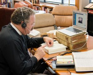 """LCMS President Rev. Dr. Matthew C. Harrison checks reference material during a Nov. 13 """"Free to Be Faithful"""" webinar he hosted that addressed Christian witness in the public square. (LCMS/Frank Kohn)"""
