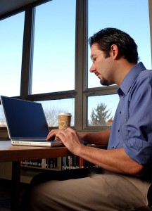 Brett Seider, a graduate student in the Information Technology program at Concordia University Wisconsin, Mequon, studies in the school library. The university has been recognized as a national and statewide leader for three of its online master's degree programs.