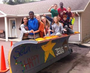 """Students from Sioux Falls (S.D.) Lutheran School show off their snowplow design, """"Happy Birthday Jesus."""" (Lutheran High School of Sioux Falls)"""