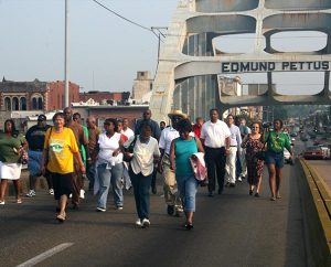 """Some 75 people who arrived early for the LCMS Black Ministry Family Convocation held July 19-23, 2006, in Selma, Ala., walked across the Edmund Pettus Bridge, recreating the march of civil-rights protesters in 1965. The theme of the convocation was """"Crossing Over."""" (Marvin Collins)"""