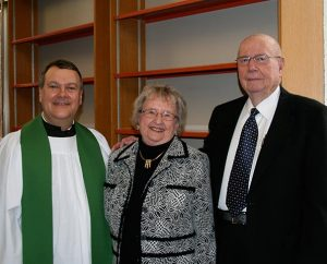 Concordia Theological Seminary, Fort Wayne, Ind., President Rev. Dr. Lawrence R. Rast Jr., left, poses with Barbara and Wayne Kroemer, who were instrumental in the expansion of the seminary's library and for whom the library is named. (Colleen Bartzsch/Concordia Theological Seminary)