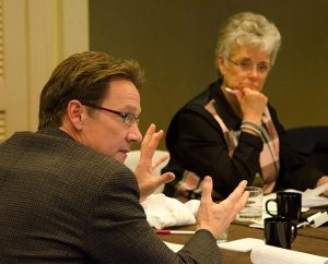 LCMS Task Force on Domestic Violence and Child Abuse member Dr. Stephen Saunders explains a point at the Jan. 30 task force meeting in St. Louis. In the background is parish nurse and task-force member Karen Hardecopf. (LCMS/Frank Kohn)