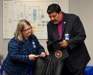 Board for National Mission members Carla Claussen and the Rev. Dr. Al Espinosa review the docket during a break at the board's Feb. 2 meeting at Concordia Publishing House in St. Louis. (LCMS/Megan K. Mertz)
