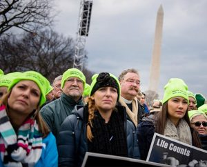Synod President Rev. Dr. Matthew C. Harrison (center) joins 380 Lutherans from around the country gathered Jan. 22 at the National Mall in Washington, D.C. — among hundreds of thousands of pro-life supporters — during the 2015 March for Life. (LCMS/Erik M. Lunsford)